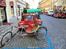 I get the Trabant car, but is that a rickshaw parked in front of it? Very Czech indeed.