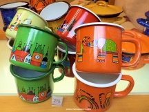 These tin pots are sold as souvenirs. Seriously? Old tinware is in most households and we hate it.