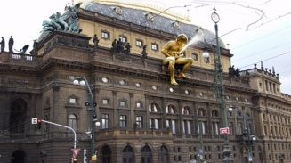 Because it's perfectly normal to put ejaculating statues on top on one's National Theatre.