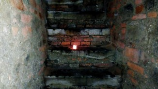 Stairs leading up to the church over the crypt