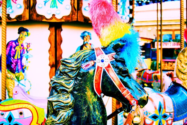The horse is wearing a cleaning duster on its head